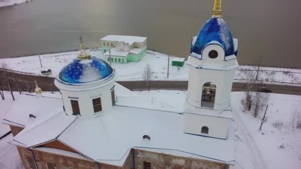 Aerial view of Church in Russia. Clip. Small town Church during snowy winter in a small town