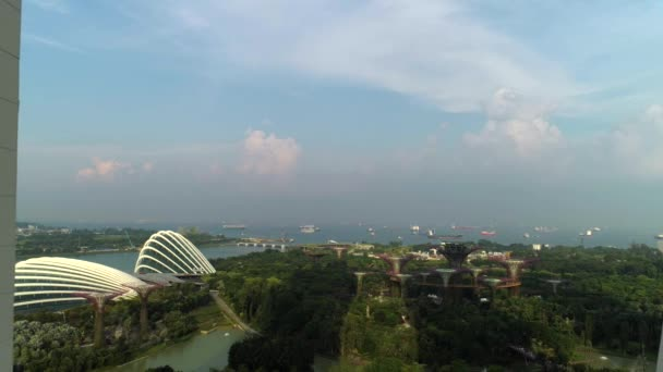 Aerial footage of Singapore skyscrapers with City Skyline during cloudy summer day. Shot. Aerial view of Singapore city