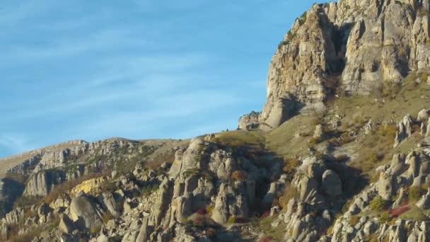 Mountain trail on rocky slope under blue sky. Shot. Wonderful view on European rocks