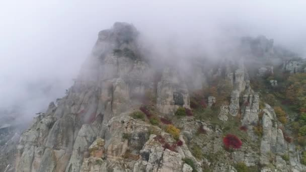 Fog over high mountain cliffs. Shot. Wonderful mountain view in early morning.