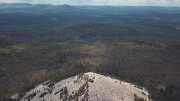 Aerial view overhand white rocky hill, forest and river. Clip. Beautiful summer landscape