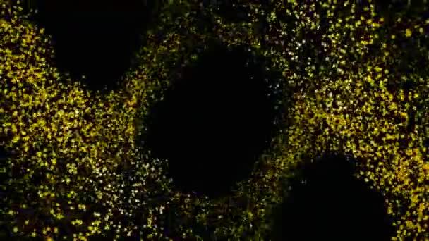 Absztrakt animáció gyönyörű repülő villogó sárga részecskék a fekete háttér. Színes ragyog.