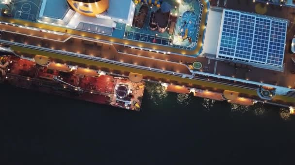 Large docked cruise ship at the sea port, top view. Stock. Sunset cruise liner with everything for the luxury vacation.