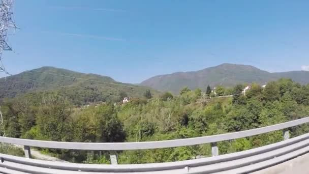 Green fresh landscape of forested hills, vacation concept, view from the car window with the fisheye effect. Scene. Beautiful view of green nature in a summer sunny day.