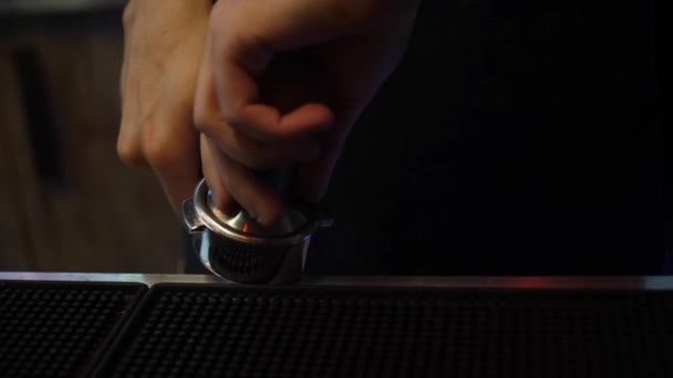 Close-up of the barista hands making fresh black coffee in a cafe or restaurant. Frame. Coffee making process