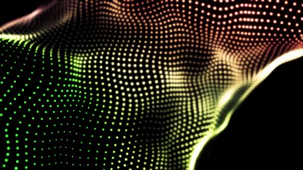 Loopable gradient mává tečkovanou texturou se zářícími rozmazanými částicemi. Animace. Zelené, červené a žluté malé kruhy tekoucí na černém pozadí, abstraktní tkaniny.