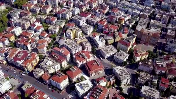 Top view of high-rise buildings with red roofs. Clip. Beautiful houses with red roofs are located close to each other in landscape of city