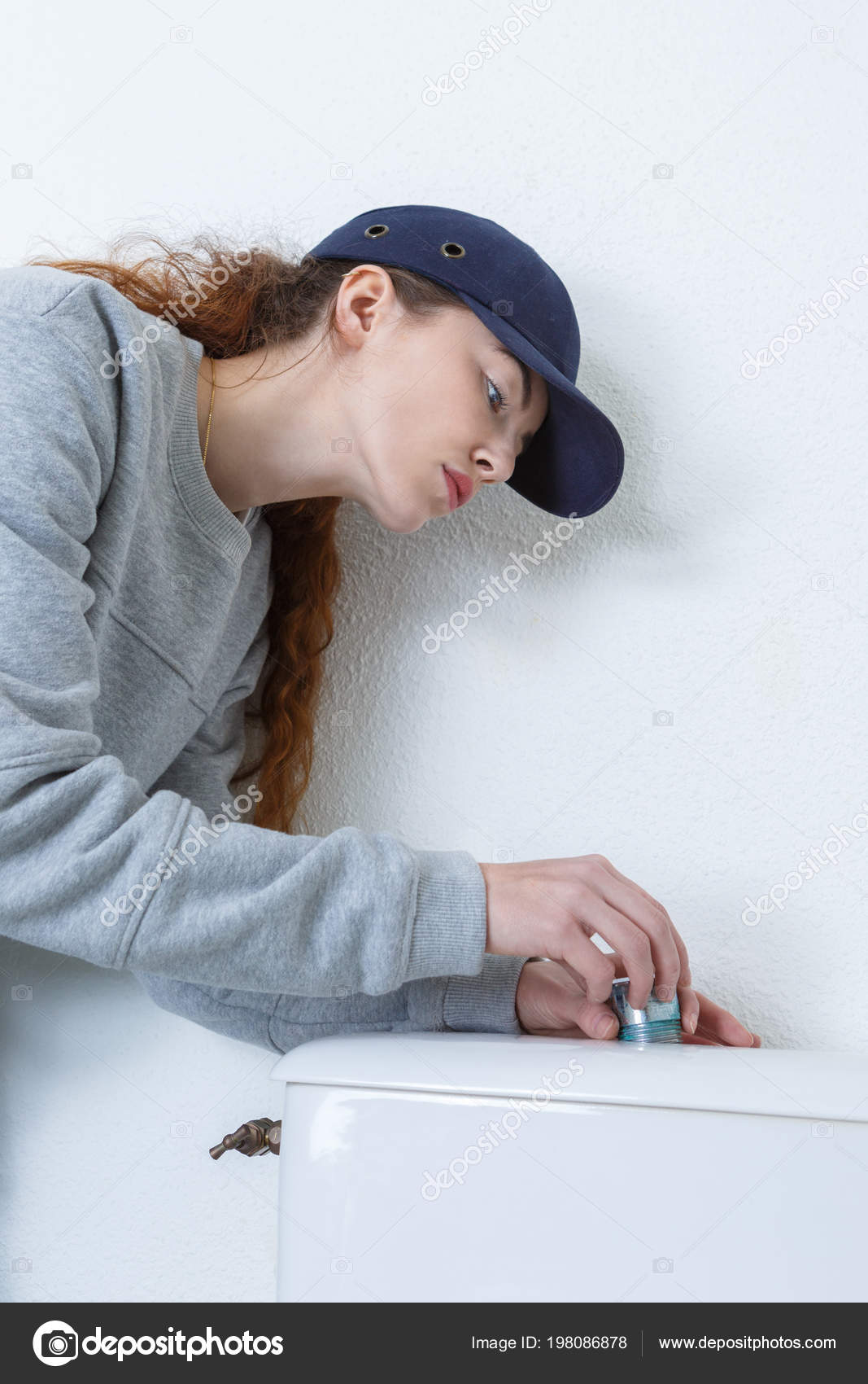 female plumber working on toilet — Stock Photo © photography33 ...