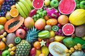 Fotografie Food background. Assortment of colorful ripe tropical fruits. Top view