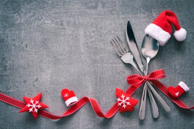 Christmas dinner table place setting with Santas hat