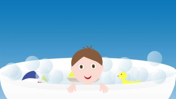 Malý roztomilý chlapeček v lázni s hračkami - člun, kachna a míč