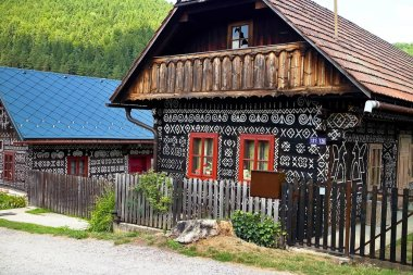 Slovak village Cicmany - famous distinctive village with decorated wooden houses with ornaments and inherent folklore and atmosphere.