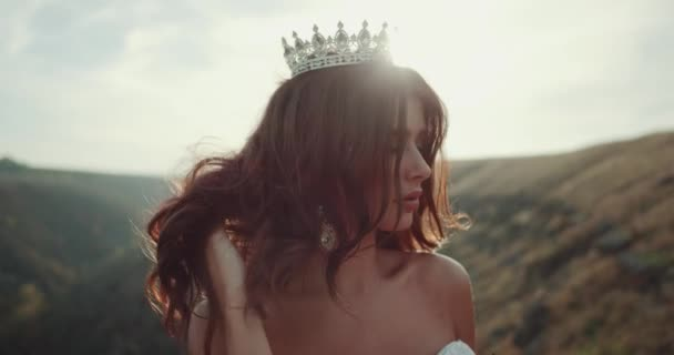 Amazing girl with the crown in the middle of landscape smelling her flowers bouquet. red epic