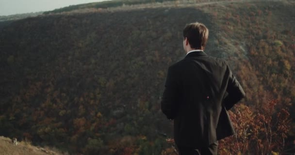 Amazing landscape view man in a suit looking around.