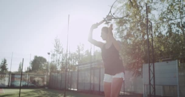 Sportiv woman playing tennis professional, at tennis court , slow motion. 4k