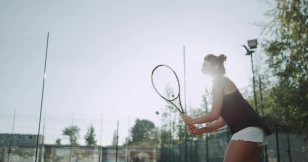Closeup equipped woman playing tennis at tennis court. slow motions