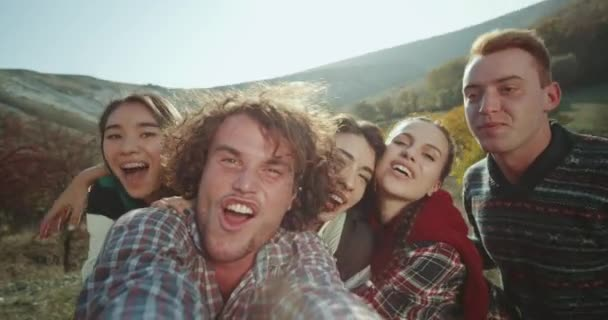 Funny friends have a good time together on the trip , they making a selfie video smiling and spending a good time together.