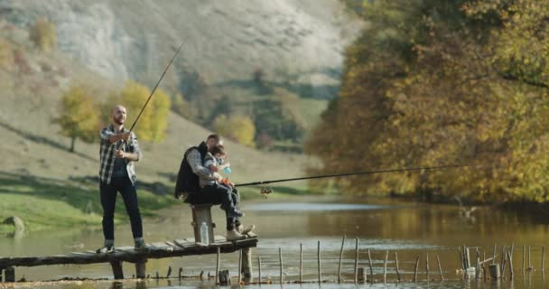 Beautiful place at nature amazing lake , two men and one litt boy fishing together