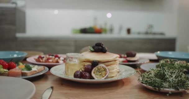 Cool slow motion shot of stacked pancakes looking yummy.
