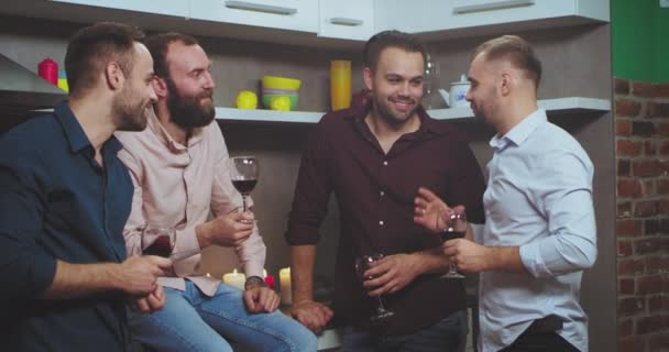 Group of multi ethnic guys at home party have a good time together , chatting and cheers the glasses of wine