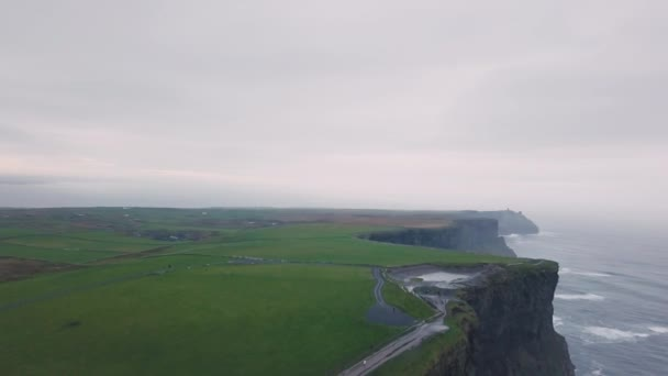 Amazing landscape view of beautiful cliffs of moher taking video with drone from the high top.