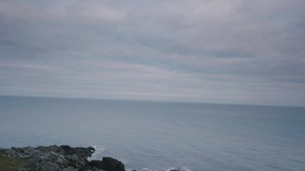 Cliffs of moher video capturing with a drone from the air , big stones and beautiful sea part.