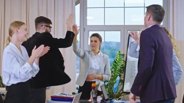 Young and mature office workers and manger in front with a team leader beautiful woman happy end the meeting after they end a good business project and happy clapping hand