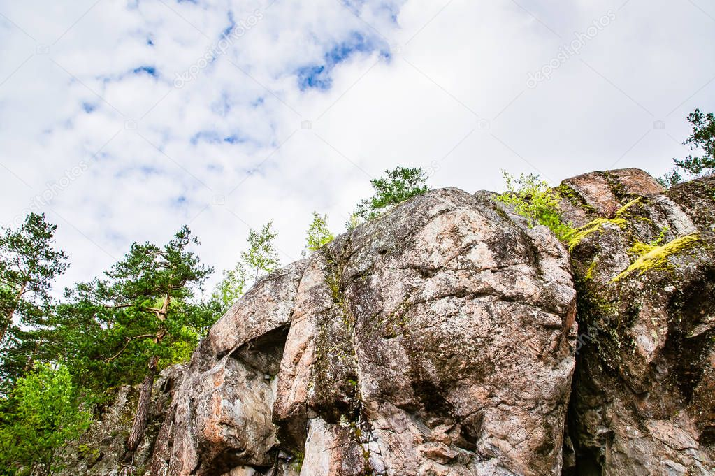 top of a high rock in the forest in Karelia