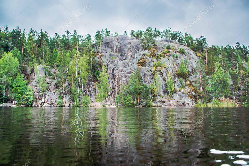 climbing rocks on the shore of a lake in Karelia