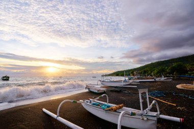 Ocean, beach and indonesian fishing boats.