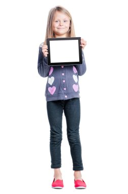 Full length of cute little girl holding tablet computer with copy space on screen