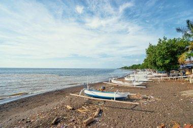 Beautiful viewof ocean, beach and indonesian fishing boats.