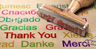 3D illustration of a rubber stamp with a thank you message written in different languages. Communication Concept