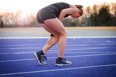 Athlete woman with calf cramp, pain in leg during running
