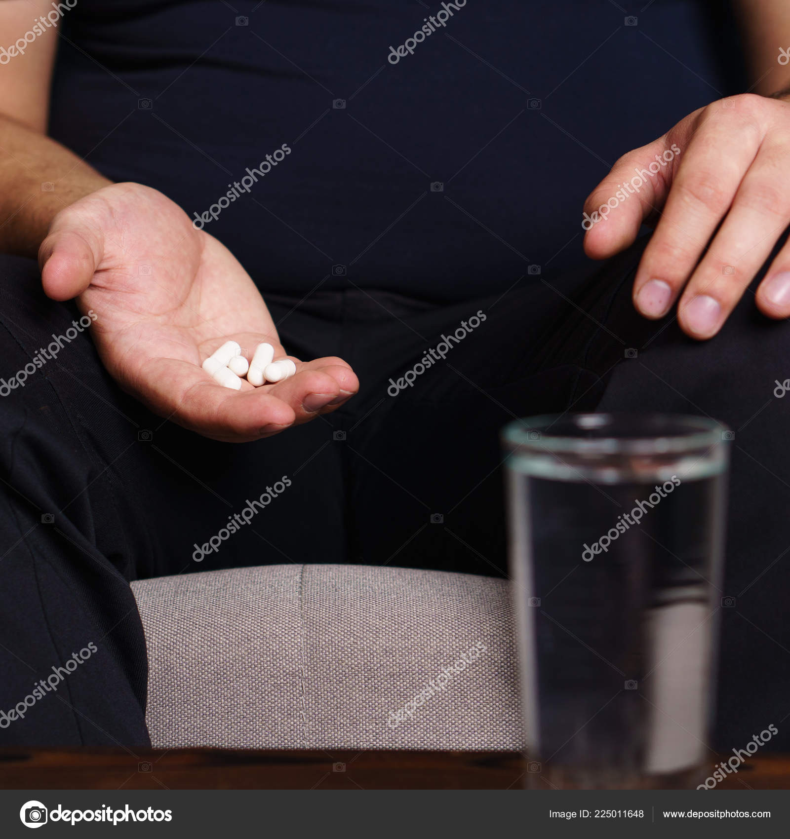 Desperate Fat Obese Man Taking Pills Weight Loss Stock Photo