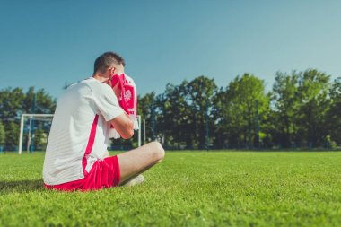 Crying Polish Football Fan After Lost Match. European Soccer Mundial Theme. Polish National Team Colors Wearing.