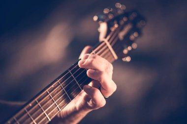 Learning Acoustic Guitar. Hands on the String Instrument Closeup Photo.