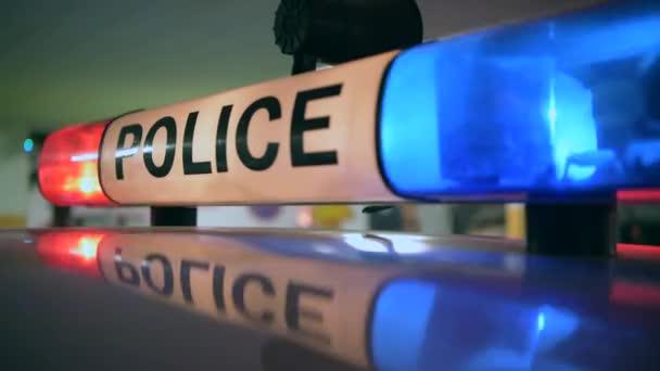 Policie křižník blikající světla Closeup. Dopravní Stop koncept