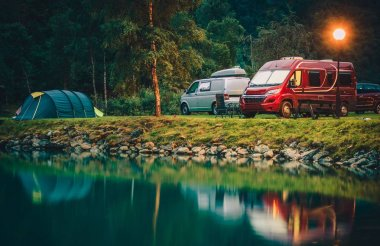 RV Park Camping in Norway. Waterfront Campsites with Camper Vans and Tents.
