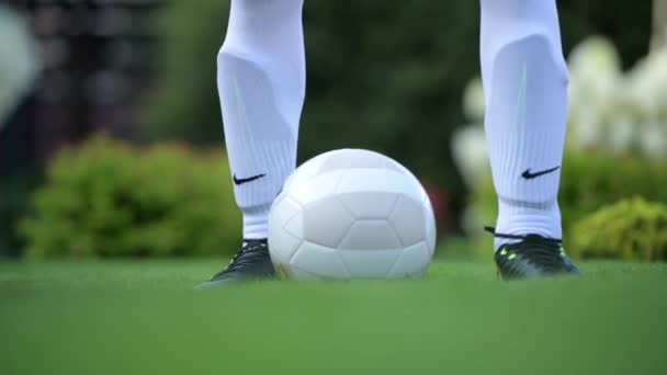 August 20, 2018. Soccer Player Preparing For a Match. Soccer Ball and Lower Part of Legs Closeup.