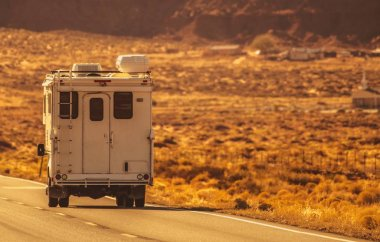 Truck Camper Road Trip Through the Northern Arizona. RV Recreational Vehicles and Travel Industry Theme.