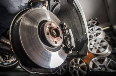 Damaged Brake Disc Replacement. Modern Vehicle in the Auto Service.