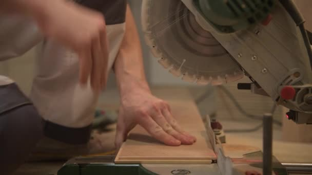 Cutting Wooden Like Floor Panel Using Circular Saw. Construction Equipment and Tools.