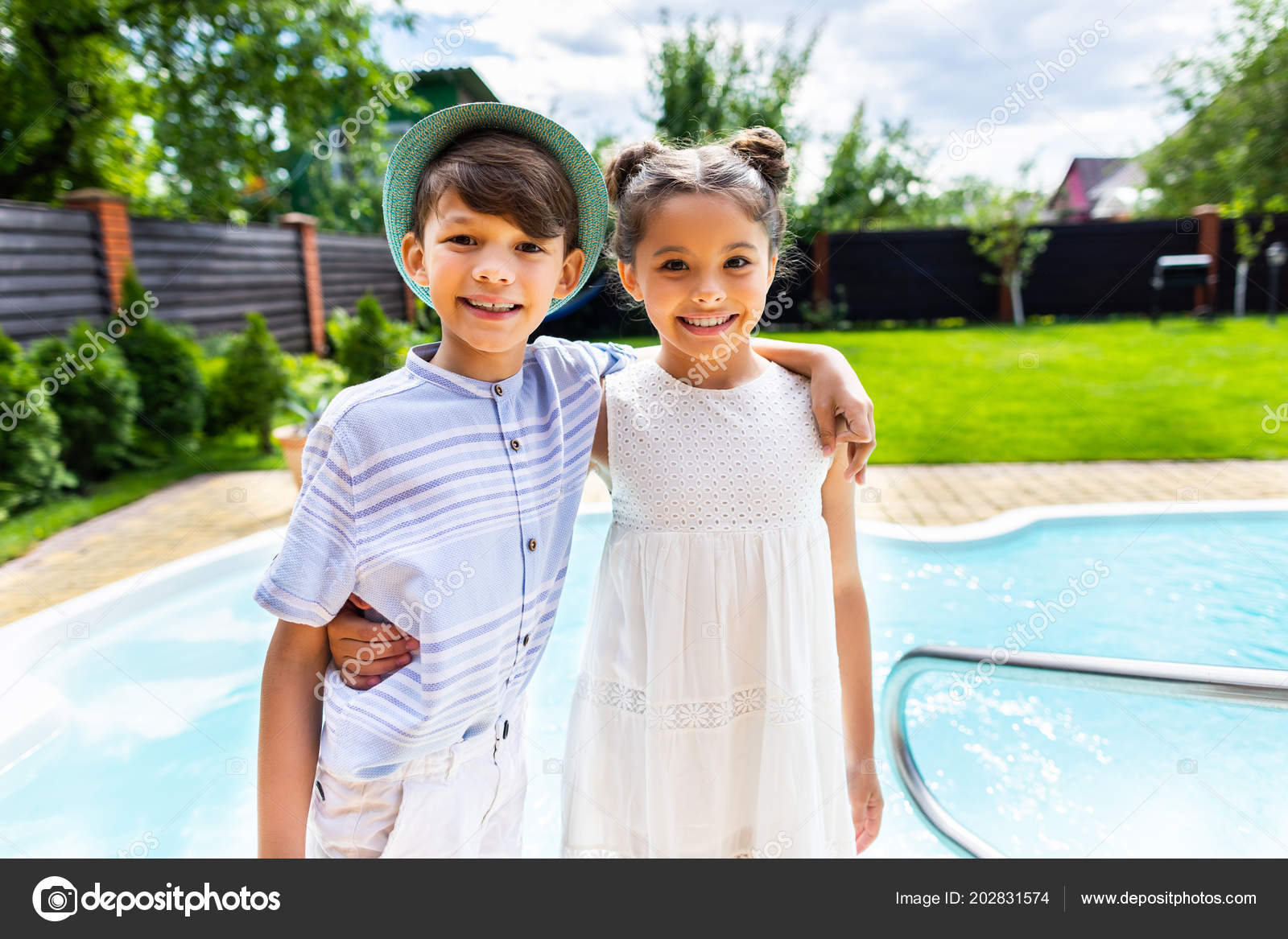 portrait smiling little siblings hugging each other swimming pool