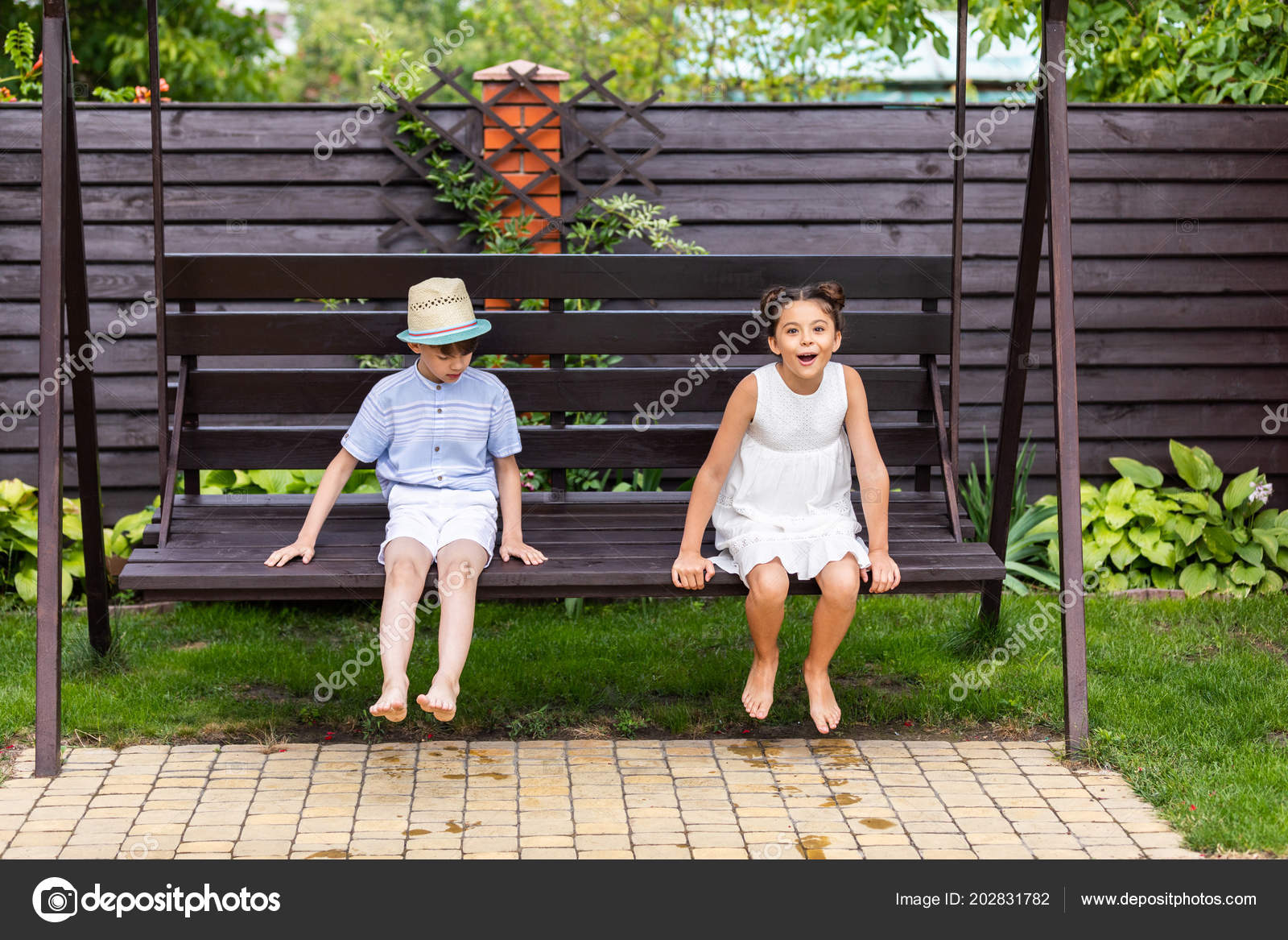 Sensational Cute Kids Sitting Wooden Bench Together Backyard Summer Day Ocoug Best Dining Table And Chair Ideas Images Ocougorg