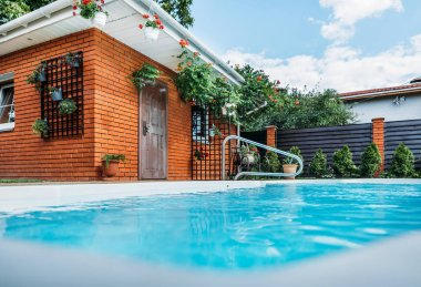 selective focus of swimming pool on country house yard