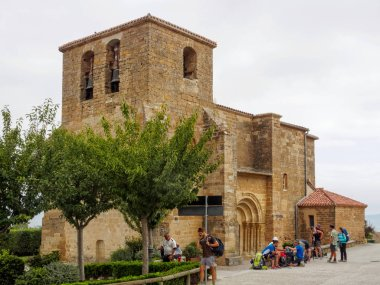 Pilgrims enjoy a well-deserved break on the Camino at the San Andrs Church (Iglesia) - Zariquiegui, Navarre, Spain, 5 September 2014