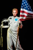 Photo beautiful female cosmonaut in spacesuit holding helmet and usa flag, isolated on black