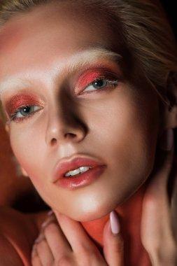 sensual woman with red makeup looking at camera