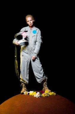Beautiful female cosmonaut posing in spacesuit with flowers and helmet on mars stock vector